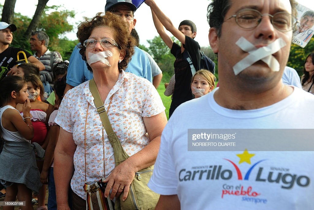 Supporters of the Frente Guasu party, whose presidential candidate Anibal Carrillo was not invited to take part in a televised presidential debate --organized by a private firm Cerneco-- tape their mouths during a protest on March 17, 2013 in Asuncion. Paraguay will hold presidential elections next April 21. AFP PHOTO/Norberto Duarte