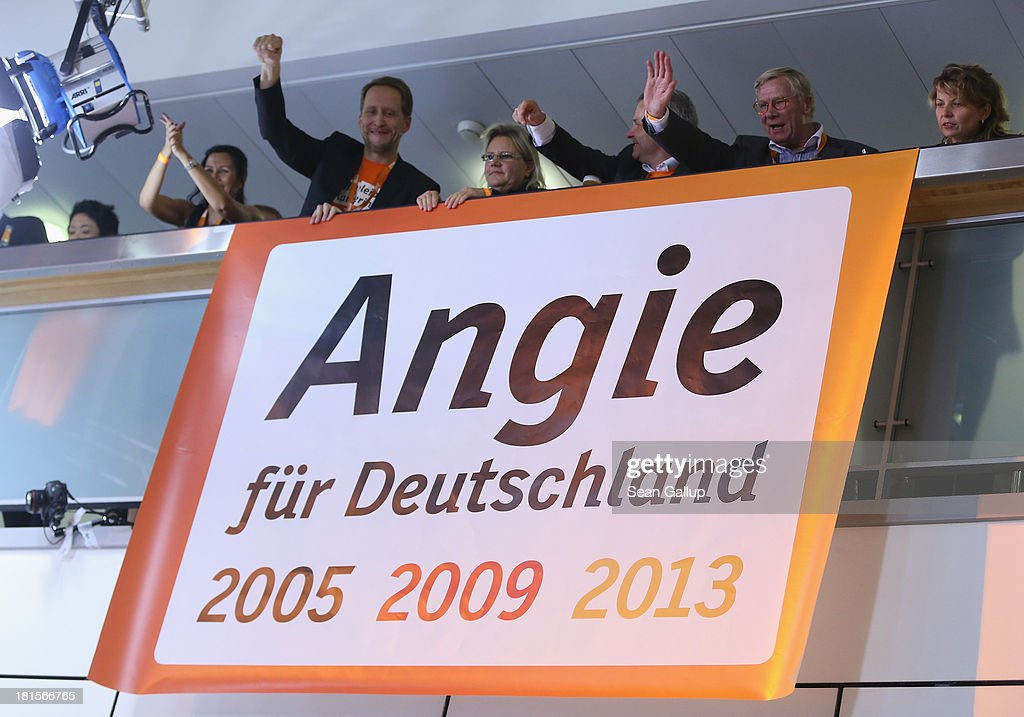 Supporters of the German Christian Democrats (CDU) unfurl a banner at CDU headquarters that reads: 'Angie for Germany' and shows the years of her potential total of three terms as chancellor after inital election results give the CDU 42% of the vote in German federal elections on September 22, 2013 in Berlin, Germany. Germany is holding federal elections that will determine whether Chancellor Angela Merkel, who is also chairwoman of the CDU, will remain chancellor for a third term. Though the CDU has a strong lead over the opposition, speculations run wide as to what coalition will be viable in coming weeks to create a new government.