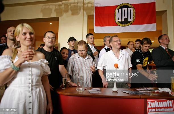 Supporters of the German farright National Democratic Party NPD celebrate election results September 17 2006 in Schwerin Germany The farright party...