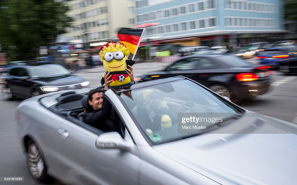 Supporters of the German national football team celebrate after winning the match against Slovakia during the UEFA EURO 2016 at Leopold Street on June 26, 2016 in Munich, Germany.