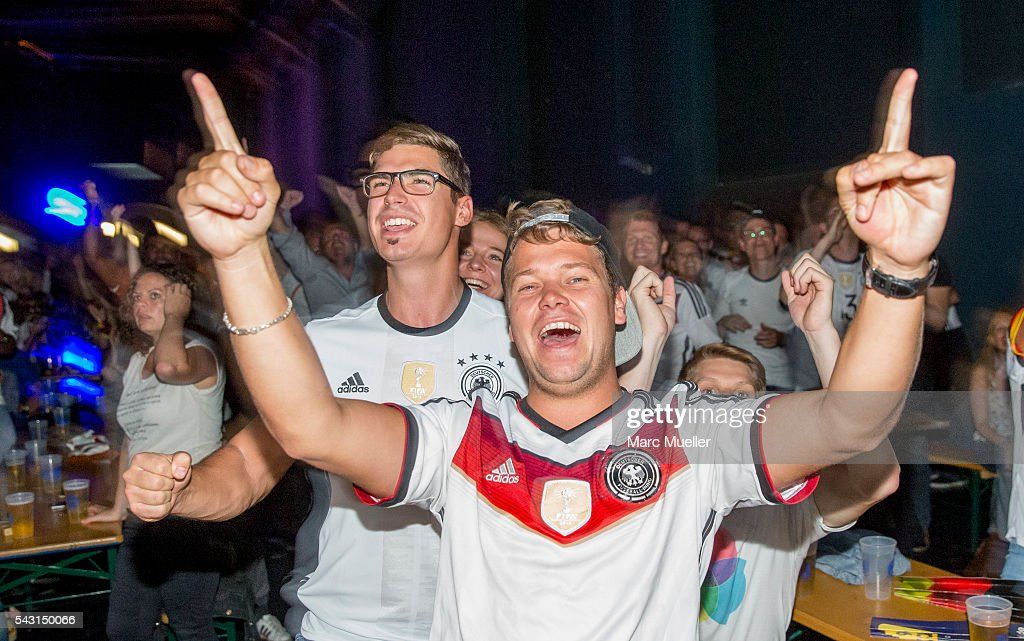 Supporters of the German national soccer team react as they watch the UEFA EURO 2016 match between Germany and Slovakia at the Muffat Hall on June 26, 2016 in Munich, Germany.