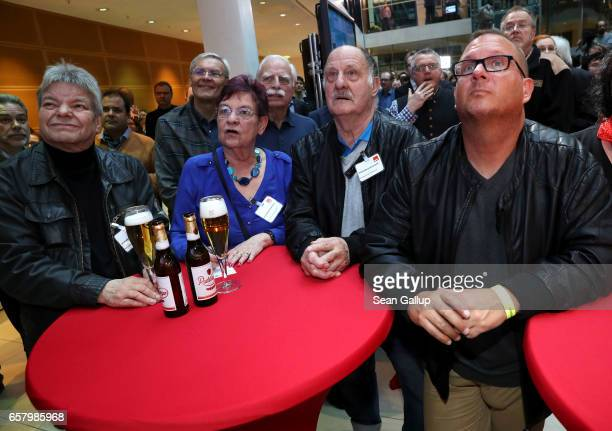 Supporters of the German Social Democrats at SPD headquarters in Berlin react to initial elections results that gave them a second place finish in...