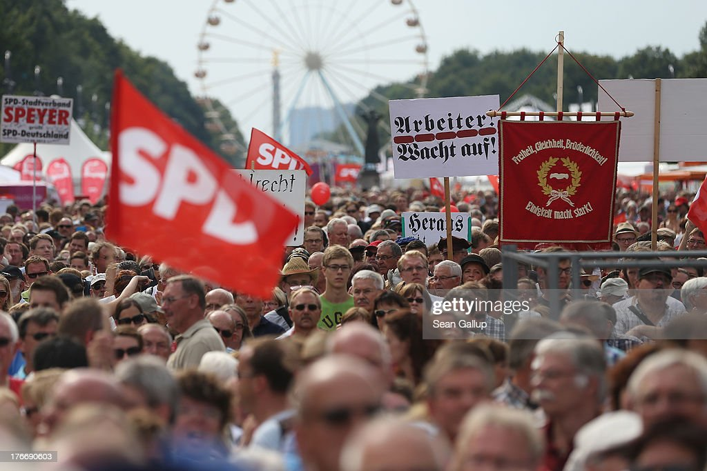 Supporters of the German Social Democrats (SPD) listen to a speech by SPD chancellor candidate Peer Steinbrueck at the 'Deutschland Fest' marking the 150th anniversary of the SPD on August 17, 2013 in Berlin, Germany. Steinbrueck is trailing incumbent Chancellor Angela Merkel and the German Christian Democrats (CDU) significantly ahead of federal elections scheduled for September 22.