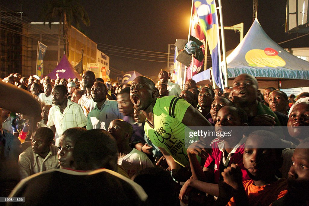 Supporters of the Ghana football team react as they watch the semi-final match of the Africa Cup of Nations between Ghana and Burkina Faso on February 6, 2013 in Accra. Rank outsiders Burkina Faso will face Nigeria in the Africa Cup of Nations final after a 3-2 penalty shootout win over Ghana. AFP PHOTO/Chris Stein