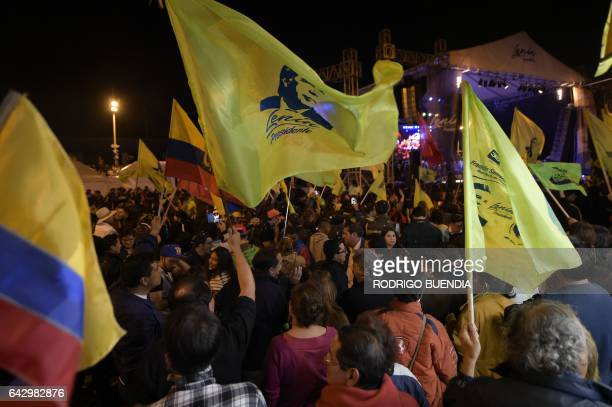 Supporters of the governing Alianza Pais party candidate Lenin Moreno celebrate in Quito on February 19 2017 after learning the results of the exit...