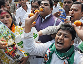 Supporters of the grand alliance JDRJD celebrate at Chief Minister Nitish Kumar's residence on the vote counting day of the Bihar assembly elections...