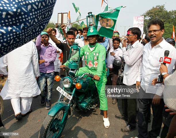 Supporters of the grand alliance JDRJD celebrate on the vote counting day of the Bihar assembly elections at JD party Office on November 8 2015 in...