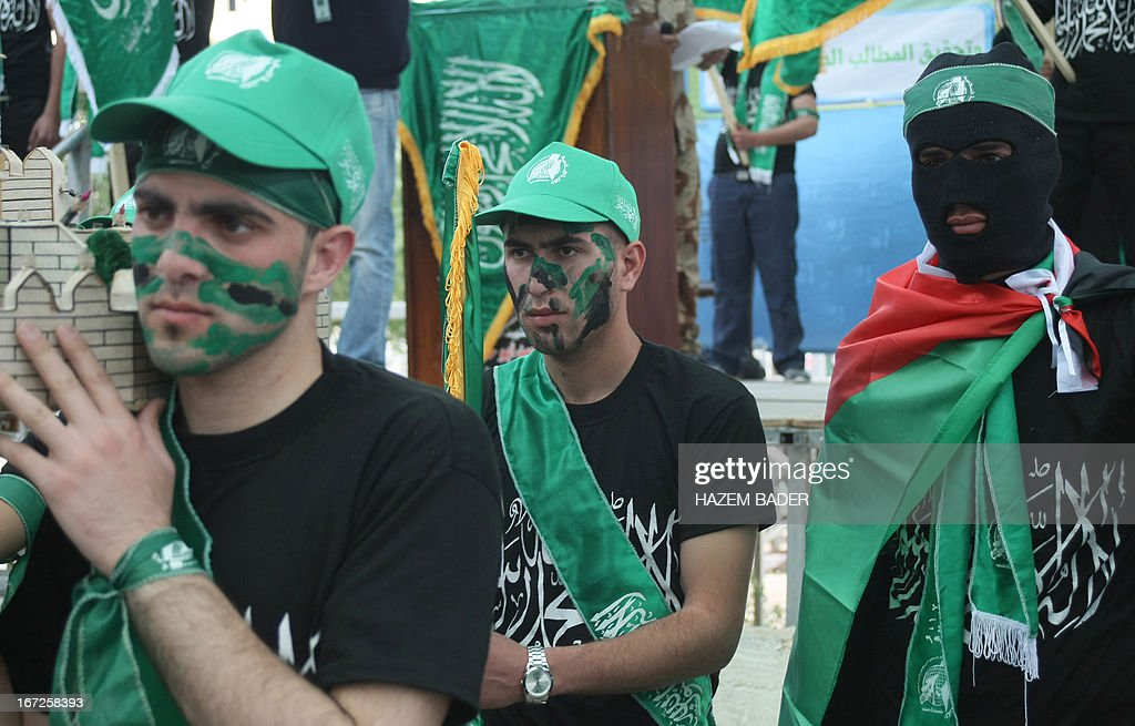 Supporters of the Hamas Islamic movement gather during a rally as part of the movement's election campaign at the Polytechnic University, in the West Bank city of Hebron, on April 23, 2013. Palestinian president Mahmud Abbas's Fatah party, which dominates the West Bank, and its rival the Islamist Hamas movement, which governs the Gaza Strip, are both contesting in the upcoming general elections.