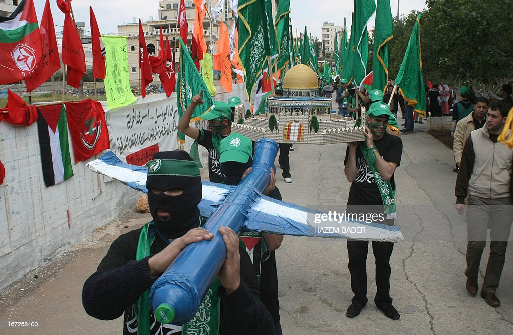 Supporters of the Hamas Islamic movement parade during a rally as part of the movement's election campaign at the Polytechnic University, in the West Bank city of Hebron, on April 23, 2013. Palestinian president Mahmud Abbas's Fatah party, which dominates the West Bank, and its rival the Islamist Hamas movement, which governs the Gaza Strip, are both contesting in the upcoming general elections. AFP PHOTO/HAZEM BADER