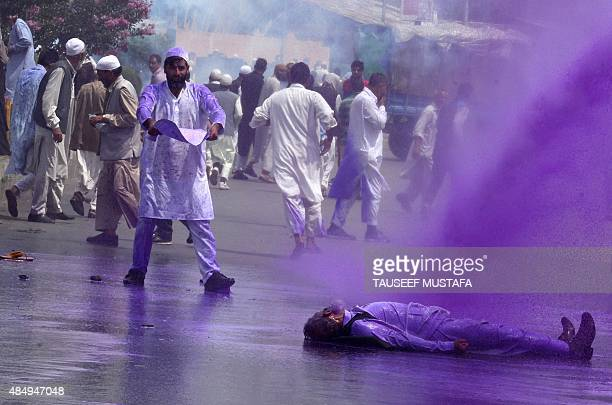 Supporters of the hardline faction of the All Parties Hurriyat Confrence clash with Indian police during a protest following the house arrest of APHC...
