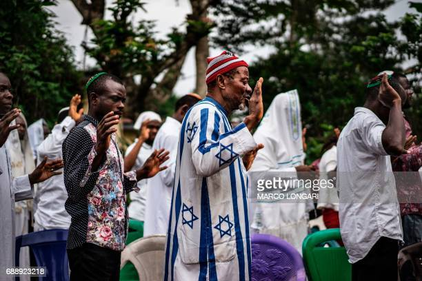 Supporters of the Indigenous People of Biafra members of the Yahveh Yashua Synagogue celebrate Shabbat outside the residence of the movement's leader...