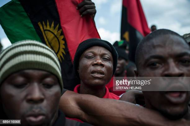 Supporters of the Indigenous People of Biafra wave Biafran flags on May 28 2017 in the Osusu district of Aba The Nigerian civil wars 50th anniversary...