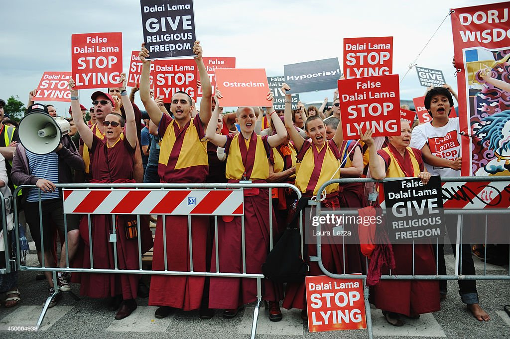 Supporters of the International Shugden Community protest against the Dalai Lama's visit outside the Modigliani Forum on June 15, 2014 in Livorno, Italy. The two-day meeting in Livorno drew about 10,000 visitors each day to the Forum to see the Dalia Lama explaining texts of Buddhist philosophers and teaching.