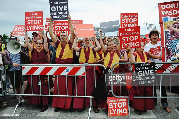Supporters of the International Shugden Community protest against the Dalai Lama's visit outside the Modigliani Forum on June 15 2014 in Livorno...