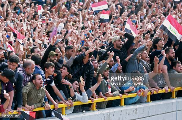 Supporters of the Iraqi Shiite cleric Moqtada alSadr wave their national flags and shout slogans during a demonstration in Tahrir Square central...