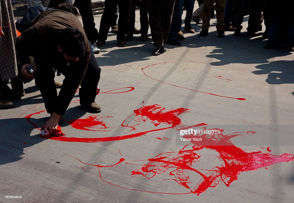 Supporters of the Jammu and Kashmir Liberation Front (JKLF) paint the road red during a protest on March 02, 2013 in Srinagar, the summer capital of Indian Administered Kashmir, India. Demonstrators wore red ribbons and painted the roads with red paint as part of a protest by pro-independence groups, such as the JKLF, who are seeking the mortal remains of Afzal Guru, who was hanged by the Indian government on February 9, 2013 for his alleged role in the 2001 attack on the country's Parliament .
