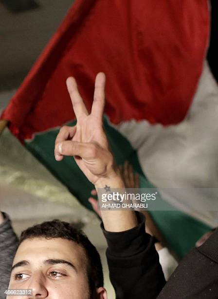 Supporters of the Joint List of Arab parties react to exit poll figures at the party's headquarters in the city of Nazareth on March 17 2015 The...