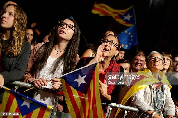Supporters of the Junts Pel Si or 'Together for Yes' party celebrate following the result of the Catalonian parliamentary election in Barcelona Spain...