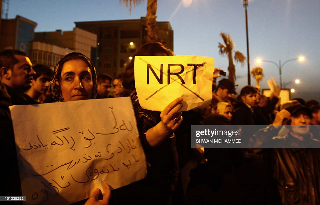Supporters of the Kurdistan Democratic Party (KDP) demonstrate in front of the office of Iraq's satellite television channel Nalia Radio and TV (NRT) accusing it of criticising the leader of the Kurdish movement Mullah Mustafa Barzani in Sulaimaniyah, in the northern mainly Kurdish region of Iraq, on February 10, 2013. A bomb exploded on the roof of Nalia's offices, a day after the broadcaster aired a caller's criticism of the revered Kurdish leader, an official said.