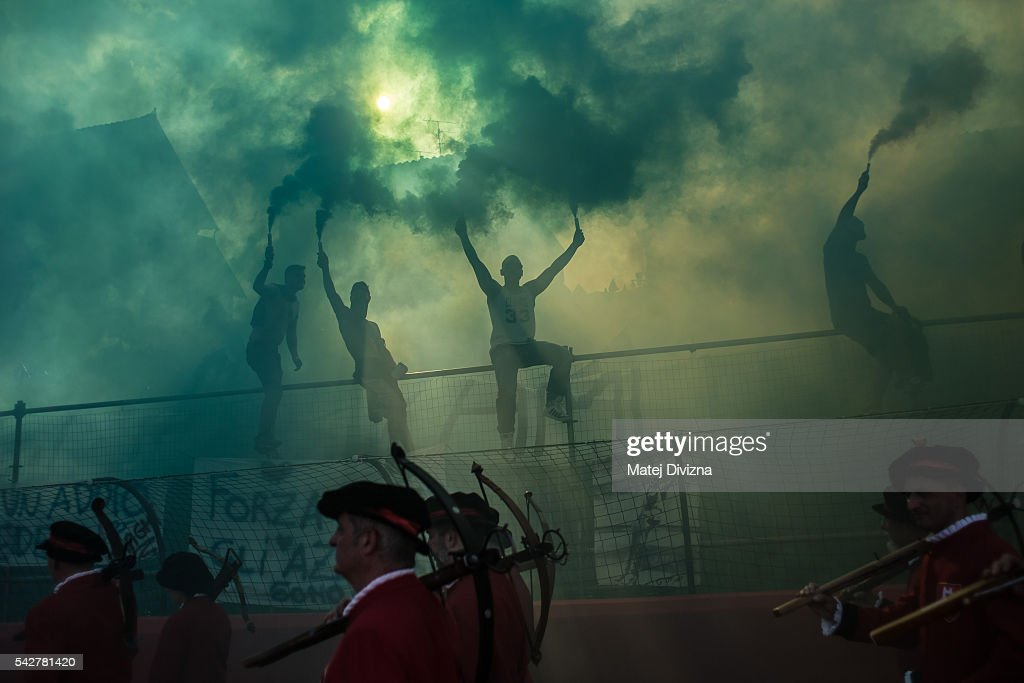 Supporters of the La Santa Croce Azzuri Team cheer on players of their team before the final match of The Calcio Storico Fiorentino between the Santo Spirito Bianchi (White) Team and the La Santa Croce Azzuri (Blue) Team at the La Santa Croce square on June 24, 2016 in Florence, Italy. The Calcio Storico (Historical Football in English) Fiorentino is an early form of football, originating in the 1500's. It is combination of football, rugby and wrestling. Now, annually during a weekend in early June, four teams representing the districts of Florence face each other in the first semi-finals. The winners go to the final, played every year on June 24, the day of the partron of Florence, St. John the Baptist. The official rules of calcio (football) were written for the first time in 1580 by Giovanni de Bardi, a count from Florence. The teams are formed by 27 players and the ball can be played either with hands or feet. Tactics such as punching, elbowing and all martianl arts techniques are allowed but kicks to the are forbidden, as are fights of two or more against one. There is a referee, a fielde master, and six linesmen. The game lasts 50 minutes, and the winning team is the one who scores most points. The playing field is a giant sand pit with a narrow split constuting the goal running the width of each end. The Calcio Storico was not played for 200 years, until its revival in 1930.