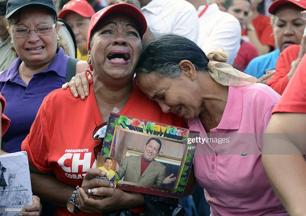 Supporters of the late Venezuelan President Hugo Chavez cry in front of the Military Hospital --where he had been hospitalized-- a day after his death in March 6, 2013, in Caracas. Venezuela was plunged into uncertainty Wednesday after the death of President Hugo Chavez, who dominated the oil-rich country for 14 years and came to embody a resurgent Latin American left. AFP PHOTO/Leo RAMIREZ