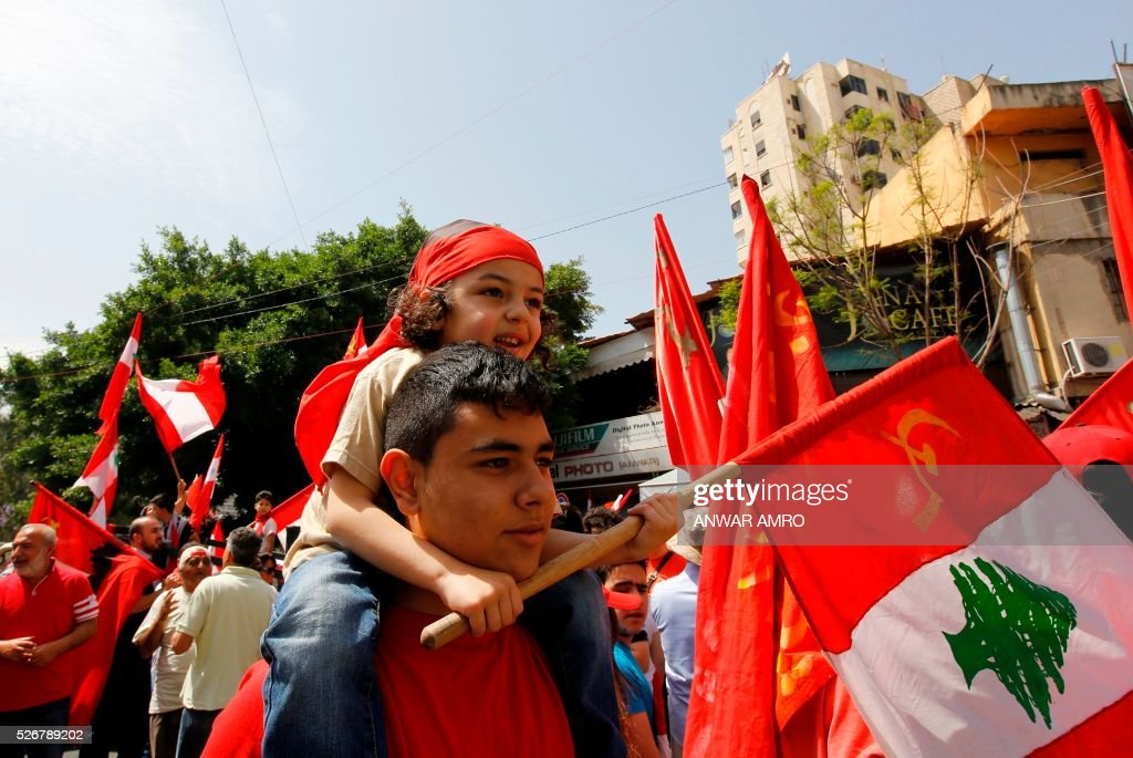 Supporters of the Lebanese Communist party take part in a May Day rally in Beirut on May 1, 2016. / AFP / ANWAR