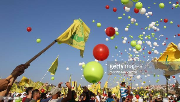 TOPSHOT Supporters of the Lebanese Shiite movement Hezbollah fly balloons during a speech by the group's leader to mark the 11th anniversary of the...