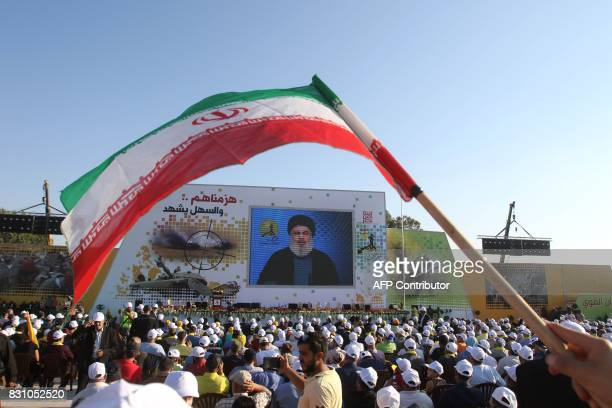 Supporters of the Lebanese Shiite movement Hezbollah watch a video screening of a speech by the group's head Hassan Nasrallah to mark the 11th...