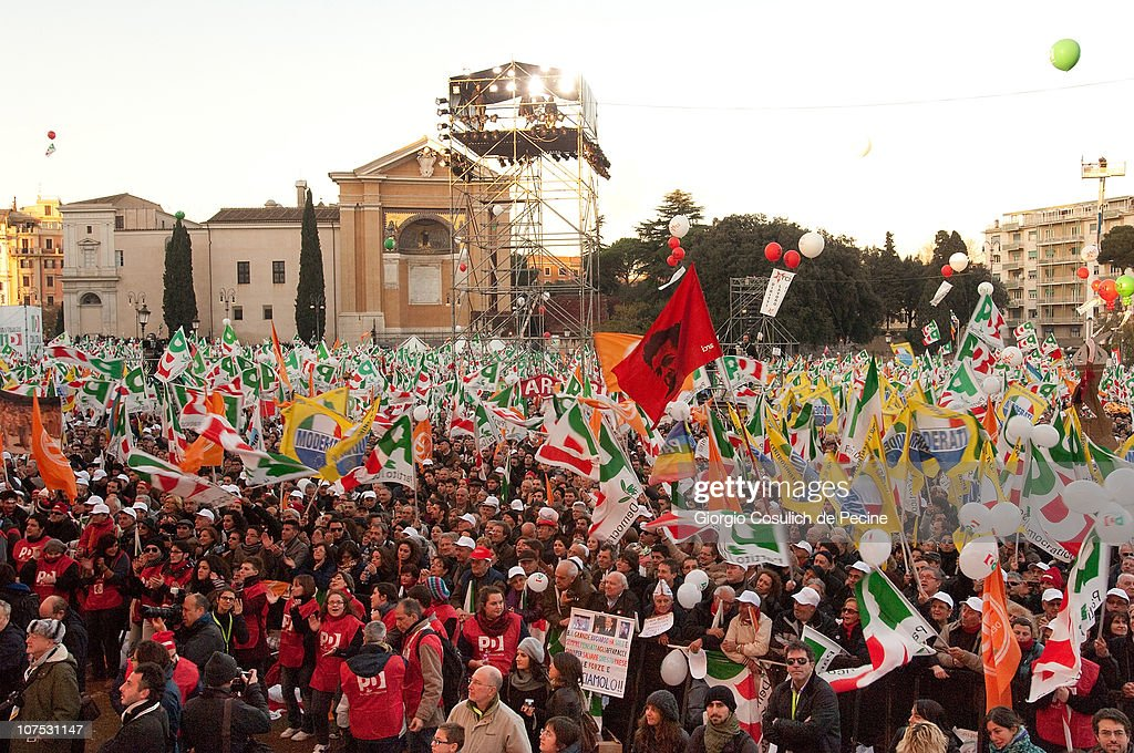 Supporters of the leftwing Democratic Party carry flags in San Giovanni square during a protest against Silvio Berlusconi's government on December 11...