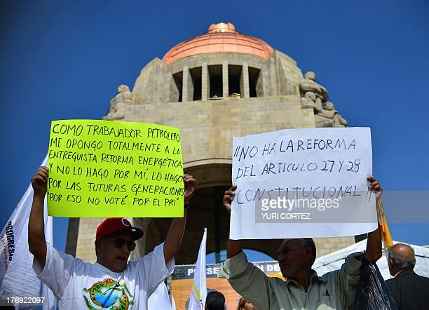 Supporters of the leftwing Party of the Democratic Revolution show a banner against a constitutional reform proposed by Mexican President Pena Nieto...