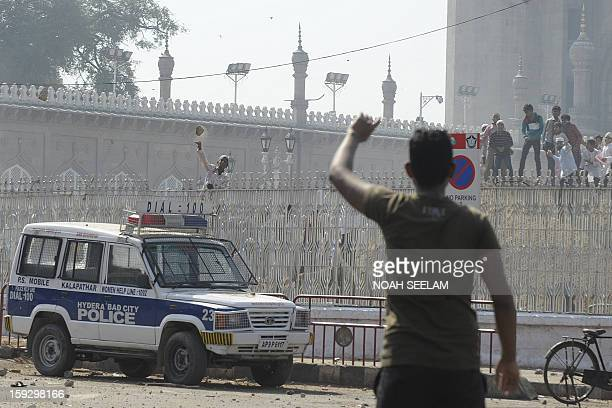 Supporters of the MajliseIttehadul Muslimeen clash with police outside the historic Mecca Masjid following congregational Friday prayers in Hyderabad...
