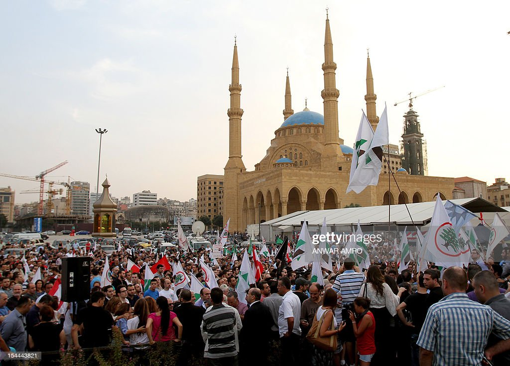 Supporters of the March 14th anti-Syrian opposition coalition take part in a protest a day after the assassination of Internal Security Forces (ISF) intelligence chief General Wissam al-Hassan in Martyrs' Square in downtown Beirut, on October 20, 2012. Lebanon was reeling the day after Hassan was killed in a bombing that was blamed on Syria and also raised fears the country is being sucked into the war ravaging its neighbour. The Mohammed al-Amin mosque is seen in the background.