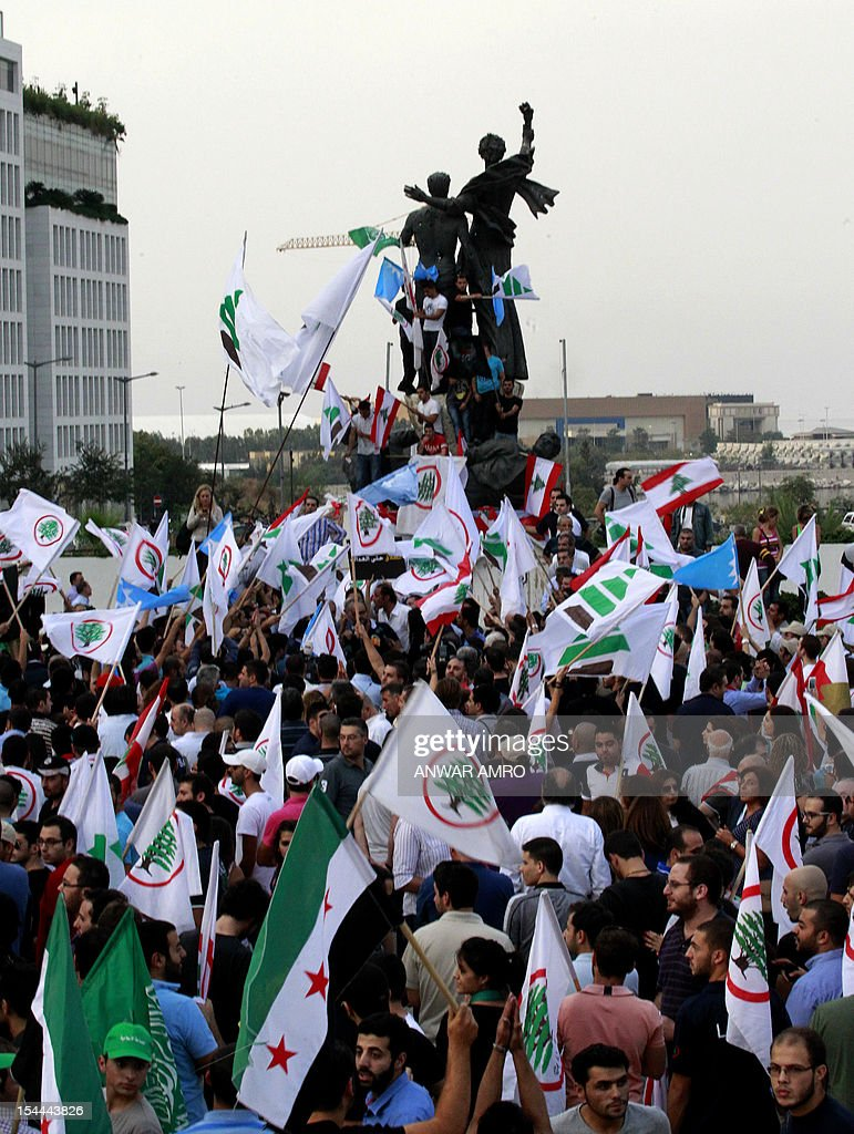 Supporters of the March 14th anti-Syrian opposition coalition take part in a protest a day after the assassination of Internal Security Forces (ISF) intelligence chief General Wissam al-Hassan in Martyrs' Square in downtown Beirut, on October 20, 2012. Lebanon was reeling the day after Hassan was killed in a bombing that was blamed on Syria and also raised fears the country is being sucked into the war ravaging its neighbour. AFP PHOTO /ANWAR AMRO