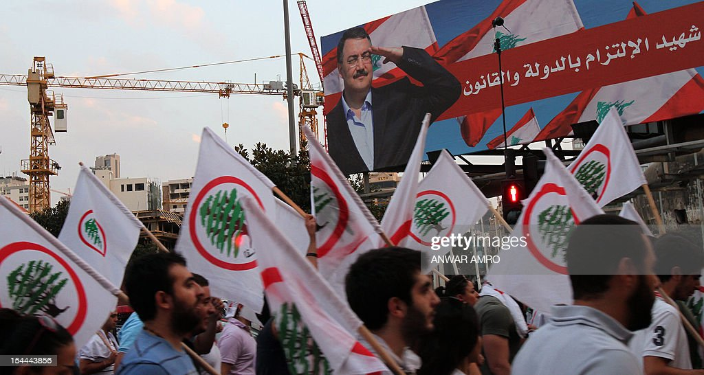 Supporters of the March 14th anti-Syrian opposition coalition take part in a protest a day after the assassination of Internal Security Forces (ISF) intelligence chief General Wissam al-Hassan (banner) in Martyrs' Square in downtown Beirut, on October 20, 2012. Lebanon was reeling the day after Hassan was killed in a bombing that was blamed on Syria and also raised fears the country is being sucked into the war ravaging its neighbour.