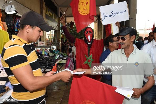 Supporters of the Moroccan party 'Ennahj dimocrati' distribute leaflets calling for the boycott of the election during the municipal and regional...
