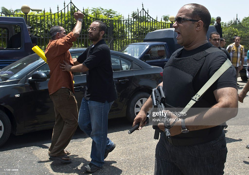 Supporters of the Muslim Brotherhood and ousted Egyptian president Mohamed Morsi are prevented from gathering outside the Supreme Constitutional...