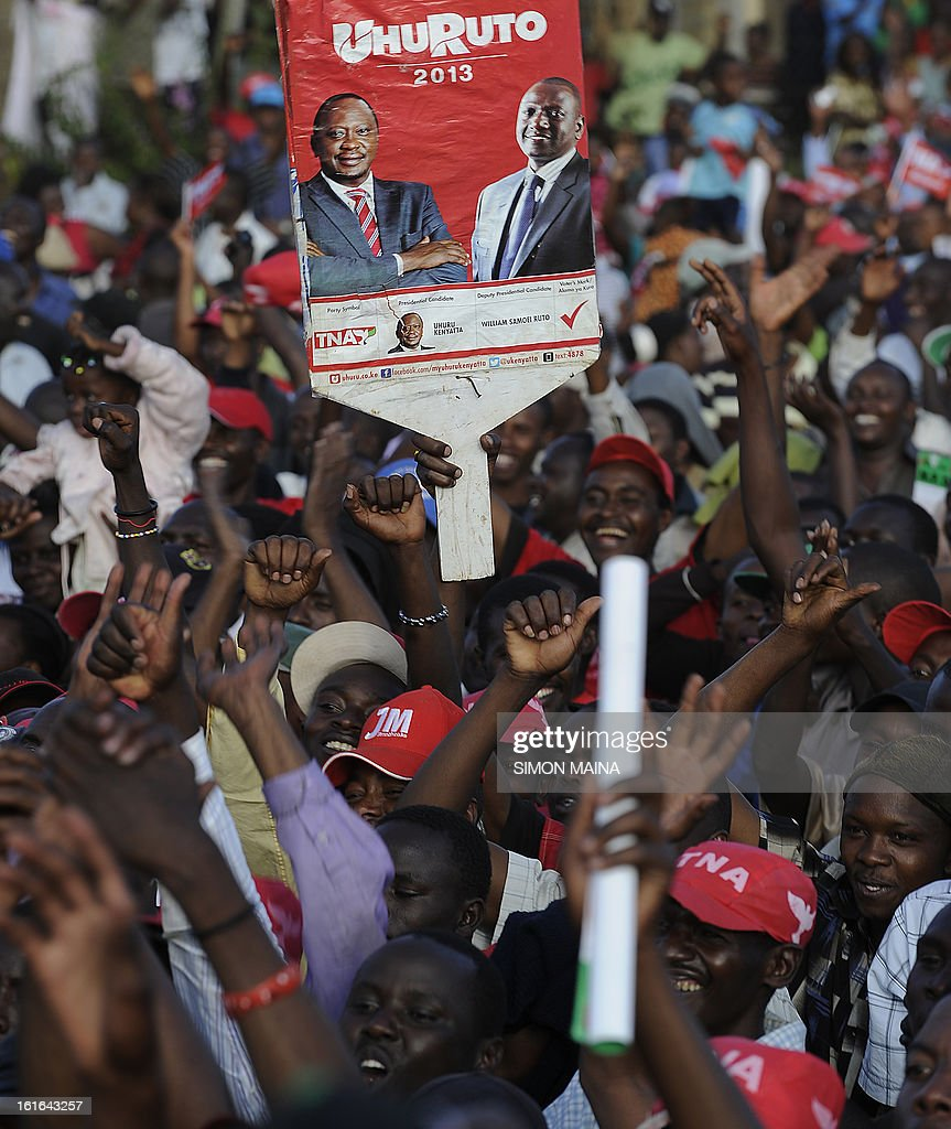 Supporters of The National Alliance gather during a party rally in the capital Nairobi on February 13, 2013. Kenya's eight presidential candidates held the country's first ever face-to-face debate this week as tensions mount ahead of next month's election, five years after bloody violence erupted in the wake of the last vote. While two main candidates -- Uhuru Kenyatta and Raila Odinga -- dominate the race for the March 4 election, all the hopefuls have potential influence, especially if voting goes to a second round run-off.