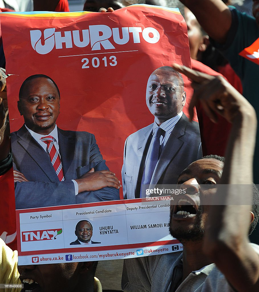 Supporters of The National Alliance hold a poster of Kenya's Deputy Prime Minister and Jubilee Alliance Presidential candidate in the upcoming Presidential elections, Uhuru Kenyatta (L) and running mate William Ruto , during a plotical rally in the capital Nairobi on February 13, 2013. Kenya's eight presidential candidates held the country's first ever face-to-face debate this week as tensions mount ahead of next month's election, five years after bloody violence erupted in the wake of the last vote. While two main candidates -- Uhuru Kenyatta and Raila Odinga -- dominate the race for the March 4 election, all the hopefuls have potential influence, especially if voting goes to a second round run-off.