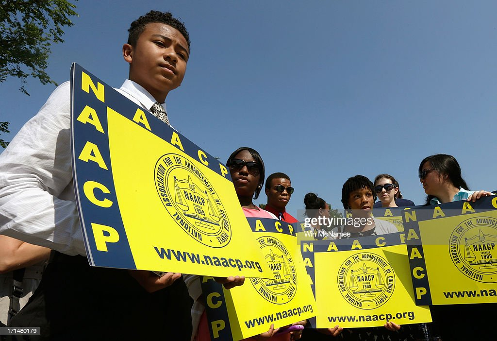 Supporters of the National Association for the Advancement of Colored People (NAACP) hold signs outside the U.S. Supreme Court building on June 25, 2013 in Washington, DC. The court ruled that Section 4 of the Voting Rights Act, which aimed at protecting minority voters, is unconstitutional. The high court convened again today to rule on some high profile decisions including two on gay marriage and one on voting rights.