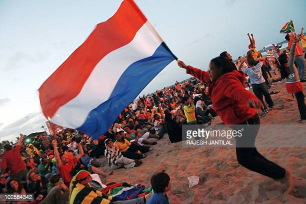 Supporters of the Netherlands wave a Dutch flag as The Netherlands scored the second goal against Brazil while watching at the Durban FIFA Fanfest...