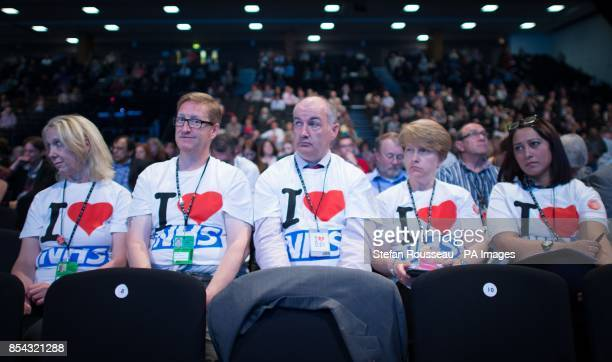 Supporters of the NHS listen to a health debate led by shadow health secretary Andy Burnham at the Labour Party conference in Brighton today