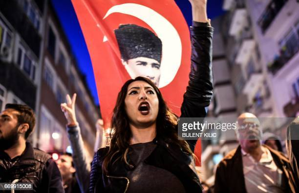 TOPSHOT Supporters of the 'No' march at Besiktas to submit their petition calling for the annulment of a referendum that approved sweeping...