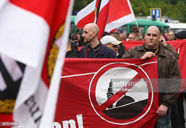 Supporters of the NPD the rightwing German political party march with a sign demanding an end to the construction of mosques in Germany in the...
