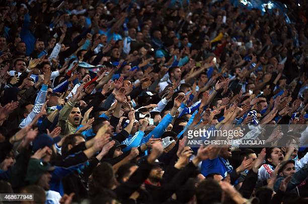 Supporters of the Olympique de Marseille react before the French L1 football match Olympique de Marseille vs Paris SaintGermain on April 5 2015 at...