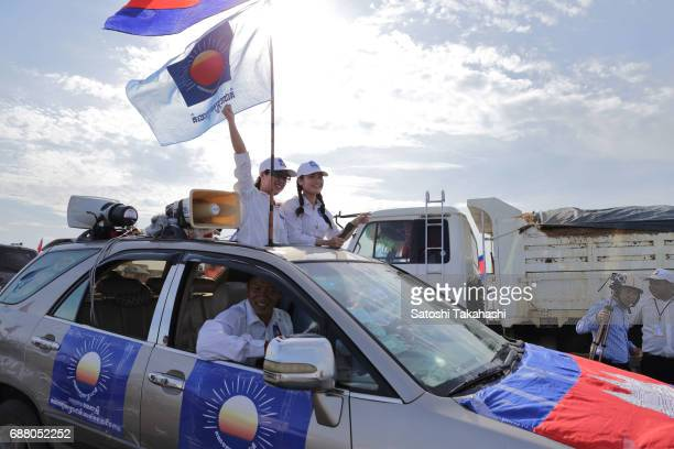 Supporters of the opposition Cambodia National Rescue Party cheer during a march on the first day of campaigning for the commune elections