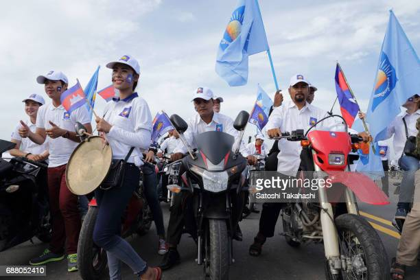 Supporters of the opposition Cambodia National Rescue Party gather for a rally on the first day of campaigning for the commune elections