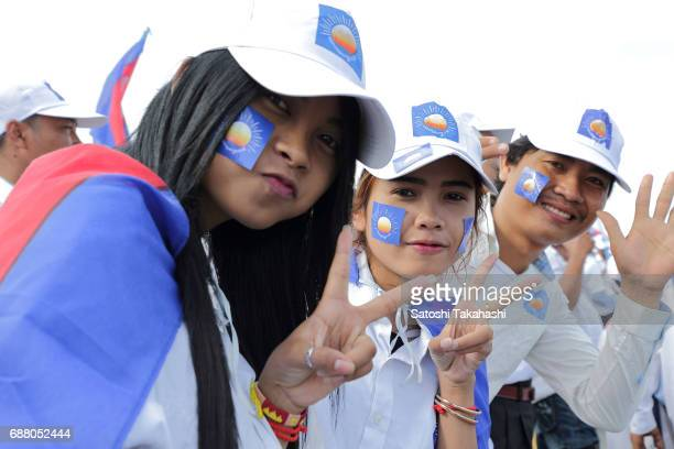 Supporters of the opposition Cambodia National Rescue Party pose for a photograph during a rally on the first day of campaigning for the commune...