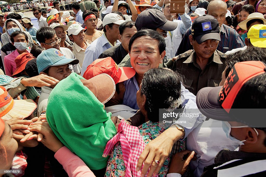 Supporters of the opposition Cambodian National Rescue Party greet CNRP Vice President <a gi-track='captionPersonalityLinkClicked' href=/galleries/search?phrase=Kem+Sokha&family=editorial&specificpeople=659005 ng-click='$event.stopPropagation()'>Kem Sokha</a> at his arrival at Freedom Park on December 15, 2013 in Phnom Penh, Cambodia. The opposition Cambodia National Rescue Party (CNRP) starts a series of daily protests today in Phnom Pehn, Cambodia, to urge Prime Minister Hun Sens government to hold a re-election following allegations of serious irregularities in the July election.