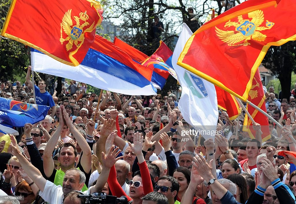 Supporters of the opposition candidate in presidential vote Miodrag Lekic wave Montenegrin and Serbian national flags during a protest in Podgorica on April 20, 2013. More than 5,000 opposition supporters protested in the Montenegrin capital against alleged fraud in an April 7 presidential election, demanding a new poll be called.