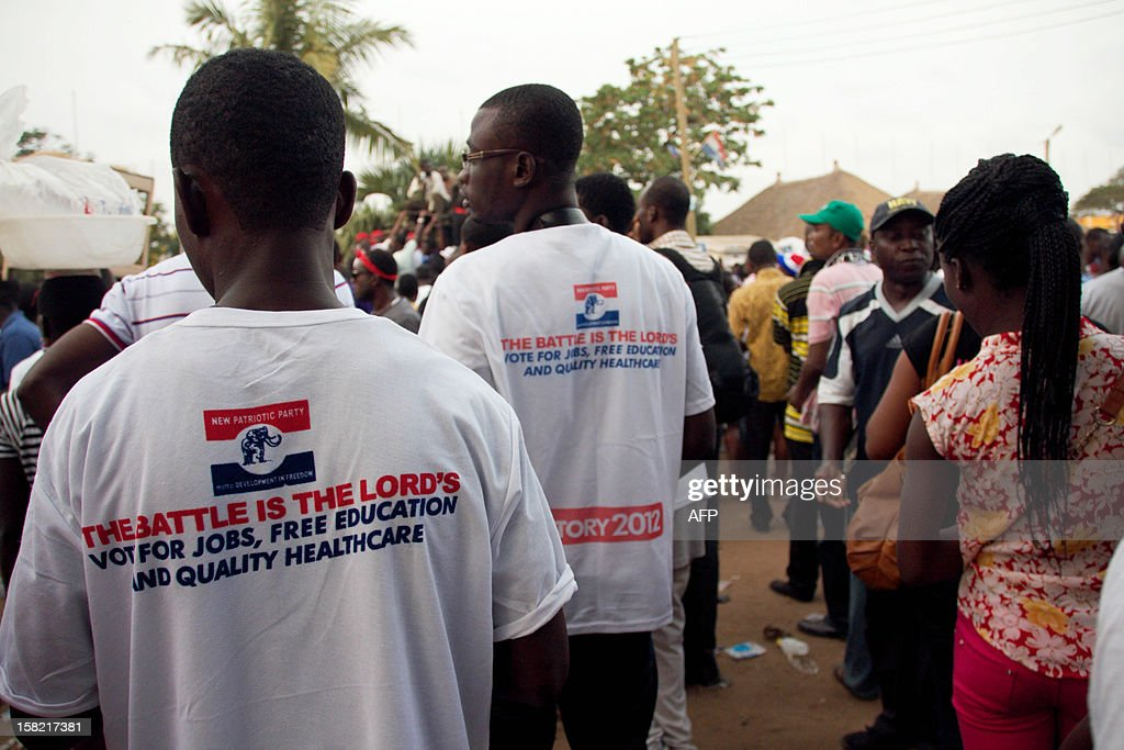 Supporters of the opposition New Patriotic Party attend a rally held by presidential candidate of the New Patriotic Party Nana AkufoAddo in Accra on...